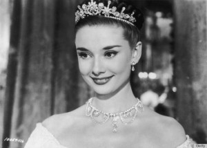 1953: Belgian-born actor Audrey Hepburn (1929 - 1993) wears a tiara in a headshot still from director William Wyler's film 'Roman Holiday'. (Photo by Hulton Archive/Getty Images)